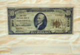 $10 bill marked First National Bank