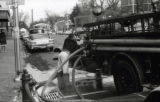 A man operates a fire truck on Division Street