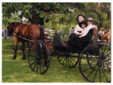Audrey, Gus and Trip DeMann in a horse-drawn carriage at Holy Cross Church, Dundas, Minnesota