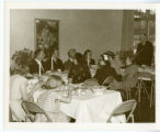 Displaced persons eating at St. John's Lutheran Church