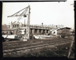 A crane outside the Northfield Iron Company, with railroad tracks running at the side